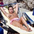 Dua Lipa – Bikini Candids in Capri - 454 x 303