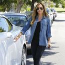 Christine Ouzounian is spotted leaving her home in Santa Monica, California and heading to a meeting in Century City on August 14, 2015
