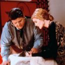 Rene Russo and Robbie Coltrane
