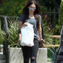 Megan Fox in Black Ripped Jeans Shopping in Malibu