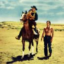 "John Wayne, Natalie Wood and Jeffrey Hunter in ""The Searchers"""