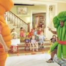 Phil (Jeff Garlin, left) and Charlie (Eddie Murphy) dress up as vegetables to amuse their child-care charges