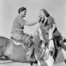 Spencer Tracy and Joan Crawford Tracy teaches Joan to play polo. 1937 - 454 x 589