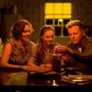 (L-r) PENELOPE ANN MILLER as Trina Baker, MADELINE CARROLL as Juli Baker and AIDAN QUINN as Richard Baker in Castle Rock Entertainment's coming-of-age romantic comedy 'FLIPPED,' a Warner Bros. Pictures release. Photo by Ben Glass