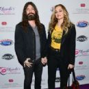 Drea de Matteo and Michael Devin  attend the 2017 Rhonda's Kiss Benefit Concert at Hollywood Palladium on December 8, 2017 in Los Angeles, California - 454 x 593