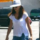 Kate Walsh takes care of her super swank Porsche convertible by filling the tires with air