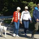 Amanda Bynes failed to show up for a mandatory hearing at a New York court on Thursday, pictured that same day walking the dogs with her parents in LA