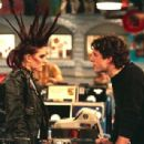 Chyler Leigh as June Tuesday in That '80s Show