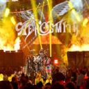 Aerosmith and Post Malone perform onstage during the 2018 MTV Video Music Awards at Radio City Music Hall on August 20, 2018 in New York City - 454 x 303