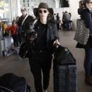 Rooney Mara arriving on a flight at LAX airport in Los Angeles, California with her dog on January 2, 2015