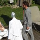 What's going on t-hair then? Supermodel Irina Shayk wears a tin-foil turban to protect her glossy locks as she stuns in TINY bikini on romantic break with Bradley Cooper