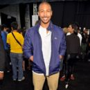 Actor Charles Michael Davis backstage at the Lacoste fashion show during Mercedes-Benz Fashion Week Spring 2015 at The Theatre at Lincoln Center on September 6, 2014 in New York City - 396 x 594