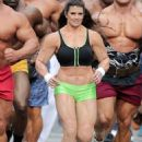 Danica Patrick displays bulky frame to film Super Bowl commercial..... but it's just a muscle suit - 454 x 602