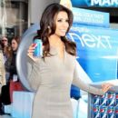 Eva Longoria happily poses with a can of Pepsi at the a Pepsi Next event in Times Square