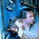 Christopher Lambert and Roxanne Hart in Highlander (1986)