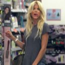 Victoria Silvstedt hits the shops in Miami at Christmas in tiny shorts, a tight T-shirt and little else