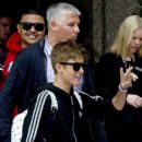 Justin Bieber leaves his hotel and is greeted by over 100 fans who were waiting to see him
