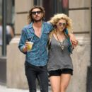 Ke$ha and rumored boyfriend Alex Carapetis look quite the couple as they walk arm in arm through Soho