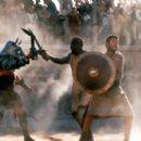 Chained together, Juba (Djimon Hounsou) and Maximus (Russell Crowe) get their first taste of gladiatorial combat in Dreamworks' Gladiator - 5/2000 - 400 x 264