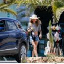 Doutzen Kroes in a cropped top and denim shorts in Ibiza - 454 x 303