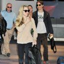 Amanda Seyfried(L) and actor Justin Long are seen upon arrival at Narita International Airport