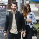 Joe Jonas and Blanda Eggenschwiler walk hand in hand after doing some book shopping at the Daily Planet Book Store in Los Feliz, California on November 20, 2013 - 454 x 573