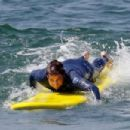 Luke Wilson shows off his surfing skills as he hits the waves for the Helen Hunt directed film 'Ride' - 454 x 303