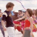 "Justin (Justin Guarini) and Kelly (Kelly Clarkson) get acquainted as they sing and dance to ""The Bounce."" (Background dancers: Brandon Henschel, Dondraico Johnson)."