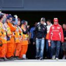 (L-R) Romain Grosjean of France and Lotus and Fernando Alonso of Spain and Ferrari attend the drivers parade before the British Grand Prix at Silverstone Circuit on July 8, 2012 in Northampton, England