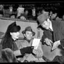 Norma Shearer and George Raft with  Boxer Ceferino Garcia with actors George Raft and Norma Shearer at Santa Anita Racetrack, Calif., 1940 - 454 x 363