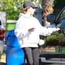 Ashley Tisdale – Seen as she exits a house in Los Angeles