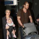 Chris Hemsworth arriving at LAX with Elsa Pataky (December 23)