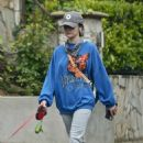 Lucy Hale – Spotted while walking her dog Elvis in Los Angeles