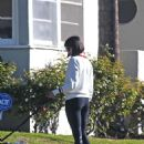 Nina Dobrev – Takes her dog Maverick for a walk in LA