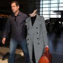Emma Stone in Long Coat at LAX Airport in Los Angeles - 454 x 681