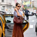 Katie Holmes – Grabs a cab in New York City