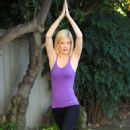 "Tori Spelling doing some Yoga on the set of ""sTORIbook Wedding"" in LA, 18-01-11"