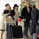 Eva Mendes and Ryan Gosling At Charles DeGaulle Airport, Paris November 27, 2011
