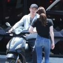 Emma Roberts and Garrett Hedlund go on a scooter ride in Los Angeles