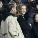 Model Barbara Palvin is joined by Kylie Jenner's ex Tyga as she watches rumoured footballer beau Neymar at PSG game in Paris