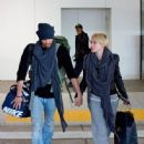 Chad Michael Murry and Nicky Whelan arrive at LAX airport on November 20, 2013 - 446 x 594