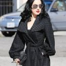 Elegant Dita von Teese heads out with her tattooed tracksuit-clad pal