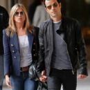 Loved up: Jennifer Aniston and Justin Theroux held hands as they stepped out for dinner in Paris