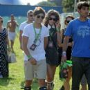 Louis Tomlinson and Eleanor Calder were spotted at V Festival yesterday, August 18, in Hylands Park