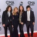 Neil Perry, Kimberly Perry, Steven Tyler, and Reid Perry attend the 48th annual CMA Awards at the Bridgestone Arena on November 5, 2014 in Nashville, Tennessee. - 454 x 576