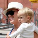 Pink helping her baby daughter Willow Sage take some of her first steps in NYC (July 15)
