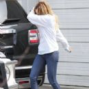 Ashley Tisdale leaving a studio and pumping gas in Los Angeles, California on April 4, 2014