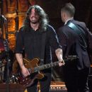 Dave Grohl and Chris Shiflett of the Foo Fighters perform onstage during MusiCares Person of the Year honoring Tom Petty at the Los Angeles Convention Center on February 10, 2017 in Los Angeles, California. - 454 x 350