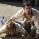 "(left to right) Taylor Handley stars as ""Dean"" and Matthew Bomer stars as ""Eric"" in New Line Cinema's upcoming horror thriller, Texas Chainsaw Massacre: The Beginning. Photo Credit: Van Redin 2005/New Line Productions"