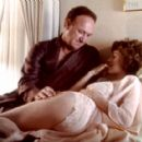Gene Hackman and Sean Young